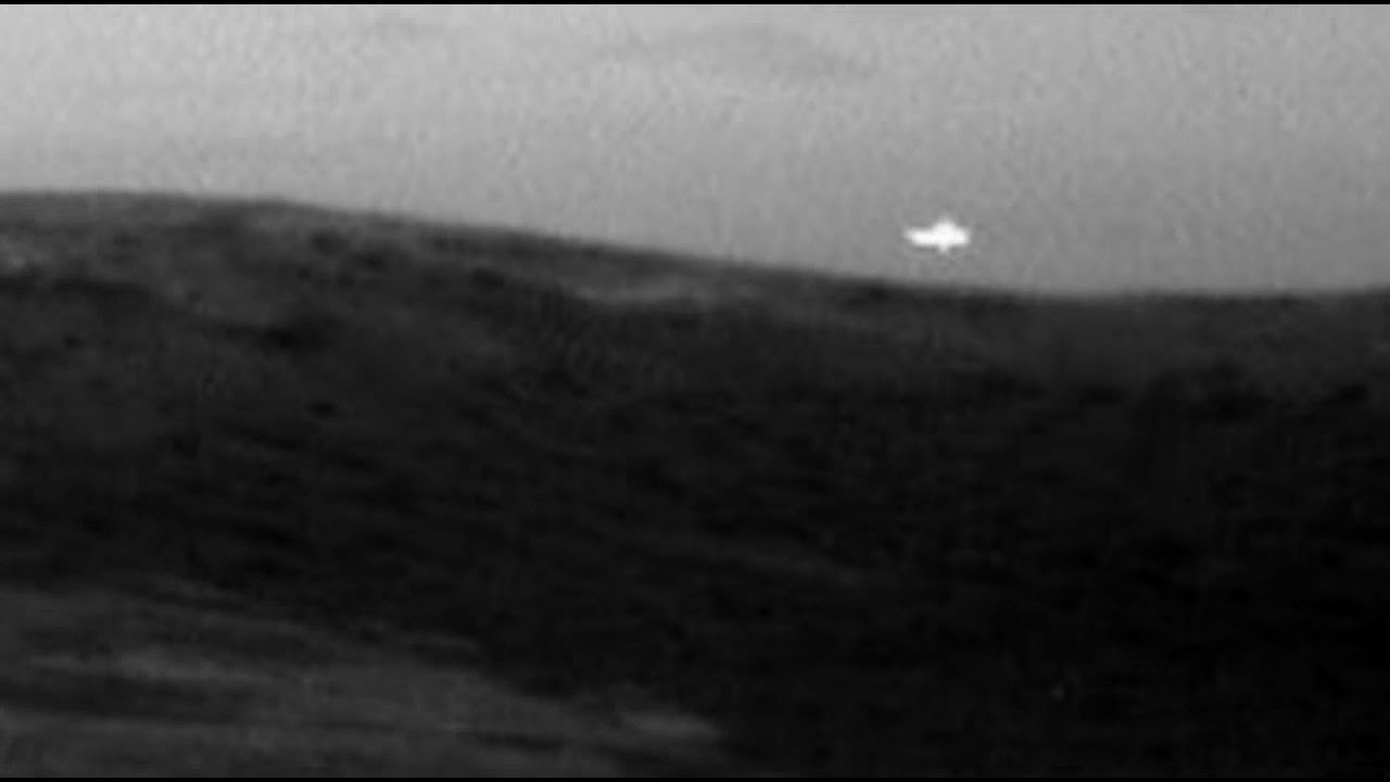 Strange Glowing Light and New Bizarre Crater Discovered On Mars