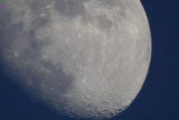 Shining UFO was spotted flying over the Moon and further on.